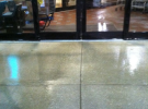 freshly pressure washed grocery store entrance